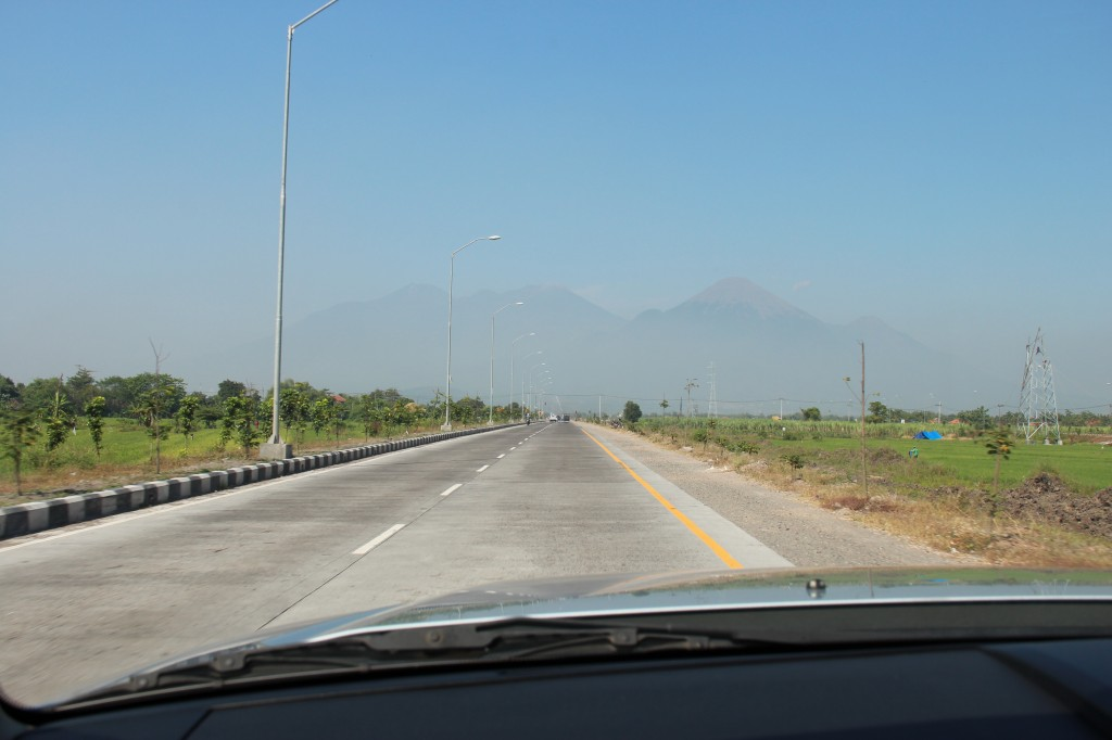 They are constantly burning their trash here, so smoke is a constant.  The Volcanos are constantly releasing ash into the atmosphere as well, so you are driving along and suddenly you see a mountain that has been there the whole time, you can just finally see it.